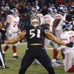 Baltimore Ravens' Ayanbadejo celebrates his sack against the New York Giants during the second half of their NFL football game in Baltimore, Maryland